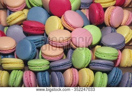 Traditional Colorful French Macarons Are Sweet Meringue-based Confection. Background