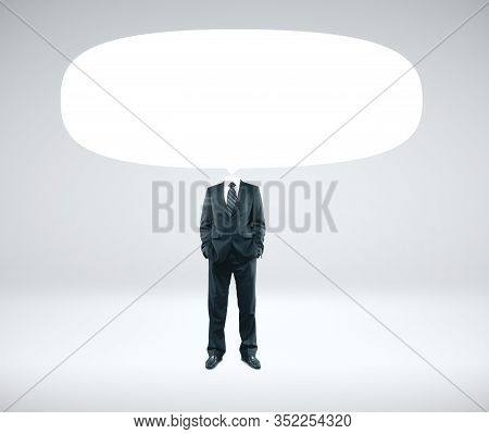 Businessman In Suit With Empty Speech Bubbles Over Head On Gray Background. Business And Communicati