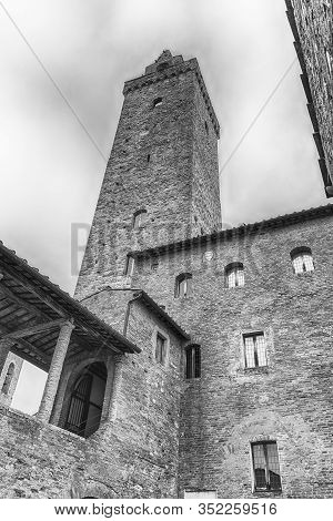View Of Torre Grossa, The Tallest Medieval Tower And One Of The Main Attractions In The Central Squa