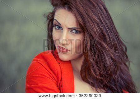 Skeptical. Closeup Confused Skeptical Woman, Having Doubt, Looking At You Camera, Isolated Green Bac