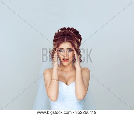 Stressed Screaming Spouse. Portrait Of A Young Woman Girl In Wedding Dress Having Stress A Headache,