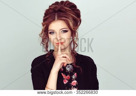 Shh. Woman Asking For Silence Or Secrecy With Finger On Lips Hush Hand Gesture Light Green Backgroun