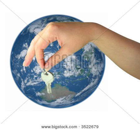 Woman Hand Giving The Key Of World Isolated Over White