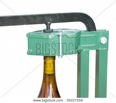 Bottle Capper And Wine Bottle (closeup View)