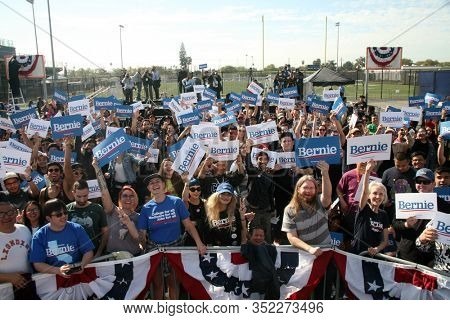 SANTA ANA, California / USA - February 21, 2010: Bernie Sanders Supporters Hold Signs, Wave, Cheer and pose for photos at a Bernie Sanders for President Rally. Editorial Use Only.