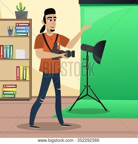 Creative Photographer In Photo Studio. Green Roll Background. Photo Studio. Office Interior. Creativ