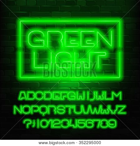 Green Light Alphabet Font. Neon Light Letters And Numbers. Brick Wall Background. Stock Vector Types