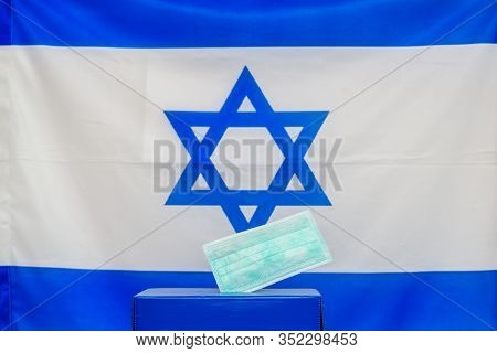 Israeli Elections. Medical Face Mask In A Box For Ballot In Election On Israel Flag Background.. Isr