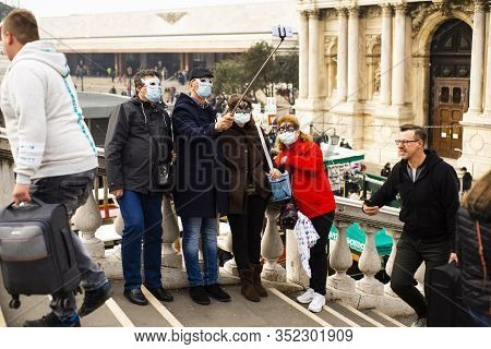 23 February 2020, Venice, Italy. The Tourists With Surgical Mask Take Selfies.