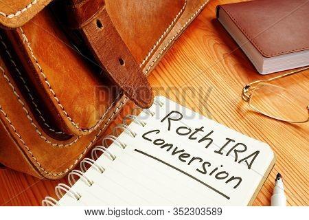Roth Ira Conversion Memo Near Retro Briefcase And Glasses.