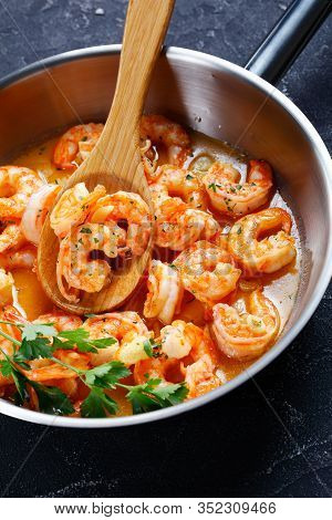 American Seafood Dish: Shrimp Scampi With Garlic And Butter Sauce Sprinkled With Parsley, On A Skill