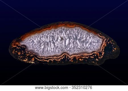 Polished Slice Of Agate And Quartz, Isolated On A Dark  Background.
