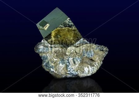 A Close Up Of Iron Pyrite Mineral Isolated On Dark/white Background.
