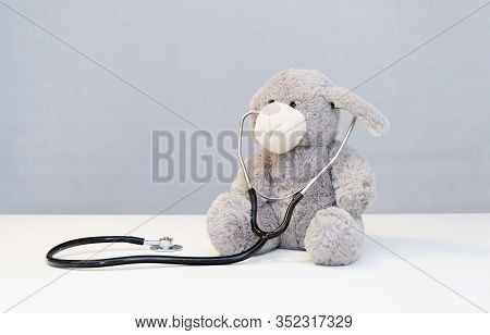 Children Doctor Concept - Teddy Bear With Stethoscope. Health Care Teddy Bear On White Background An