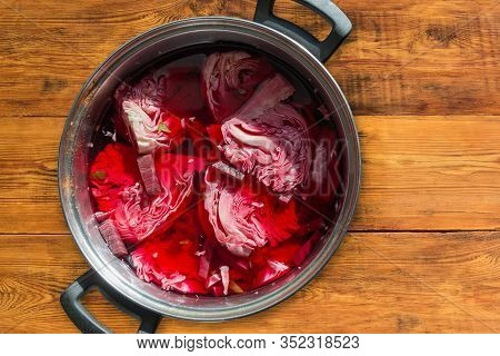 Pieces Of Heads Of White Cabbage Pickled With Beetroot In Brine In The Stainless Steel Pot On The Ru