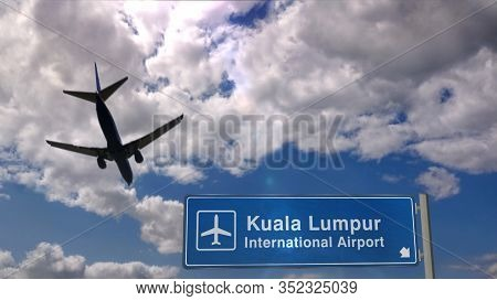 Airplane Silhouette Landing In Kuala Lumpur, Malaysia. City Arrival With International Airport Direc