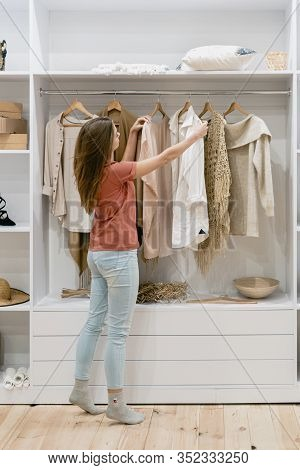 Ponder And Young Adult Woman Standing Near Wardrobe In Room, Choosing Trendy Wear, Dressing At Morni
