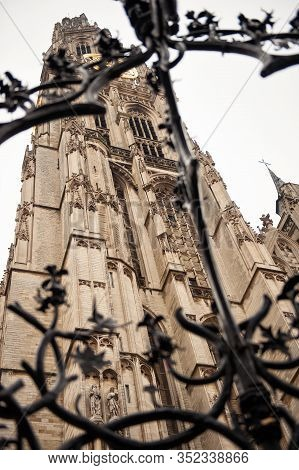 Conceptual Vertical View Of Bell Tower Of Cathedral Of Our Lady In Antwerp, Belgium. Famous Huge Fle