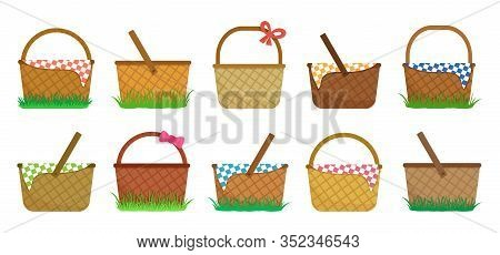 Easter Or Picnic Baskets, Set Of Straw Baskets On The Grass And With Colorful Checkered Tablecloth.