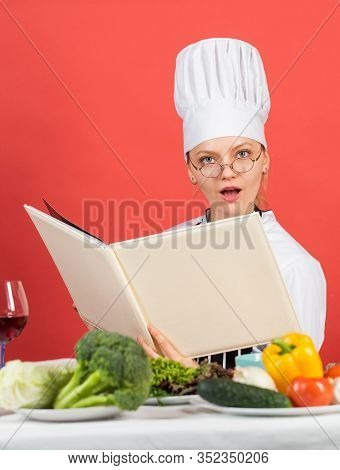 Woman Use Cookbook. Professional Chef Read Recipe For Cooking. Female Chef Preparing Dish. Cook In H