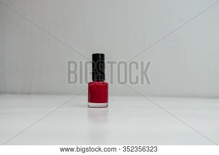 Red Colorful And Bright Nail Polish Isolated With Copy Space.