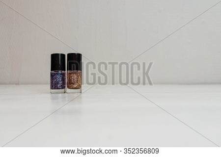 Colorful, Bright And Glittery Nail Polish Bottles Isolated On White With Copy Space. Collection Of B
