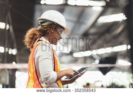 Woman Engineer Industrial Plant With A Tablet In Hand, Engineer Looking Of Working At Industrial Mac