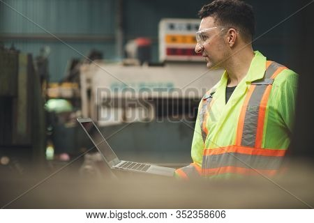 Close Up Hand Industrial Industrial Plant With A Laptop In Hand, Engineer Looking Of Process Perform