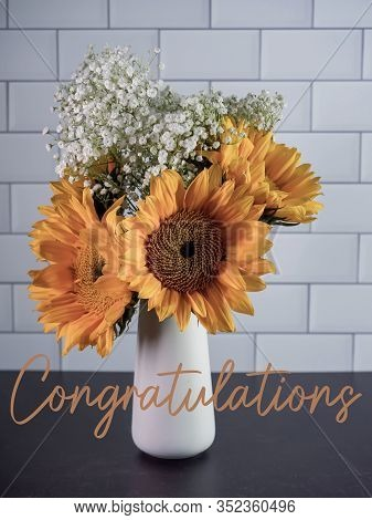 Yellow Sunflower And White Babies Breath Flower Arrangement In A White Vase On A Black Slate Base Wi