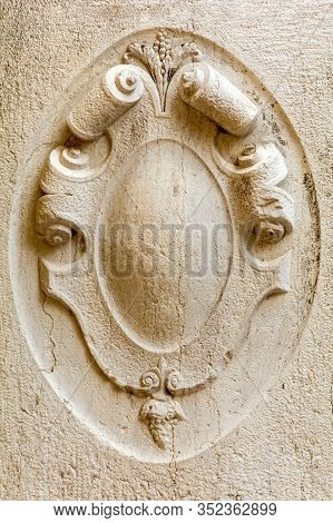 Architectural Detail Of Old Building. Stone Frame. Bas-relief Board