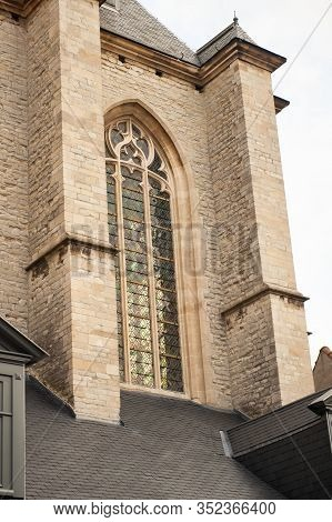 Vertical Close-up Picture Of Exterior And Stained Glass Window Of Cathedral Of Our Lady In Antwerp,