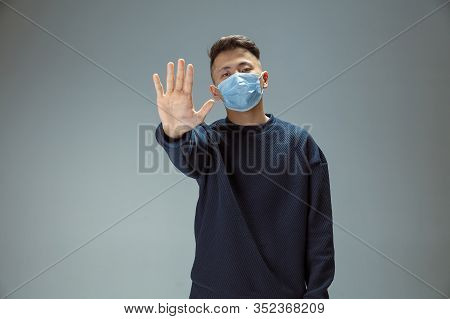 Stop Desease. Chinese Man In Blue Protective Mask Posing. Prevention Against Pneumonia Respiratory S