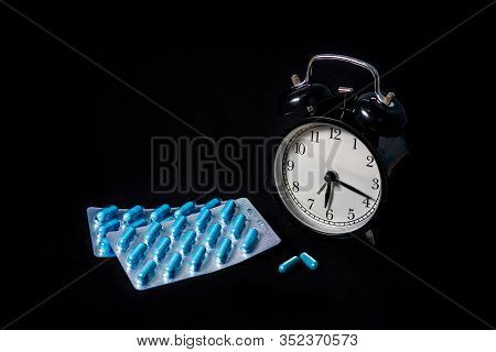 Two Packages Of Blue Capsules And A Watch. Time To Drink Medicine. Pills For Mens Health And Sexual