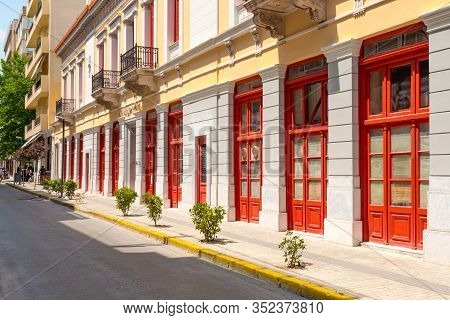 Modern Building With Wide Red Doors. Bright Street Of Europe. Greek Modern Architecture. Part Of Bui