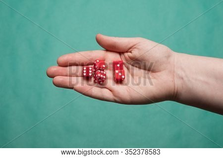Human Hand With Dice. Set Of Dice. Dice In A Female Hand.