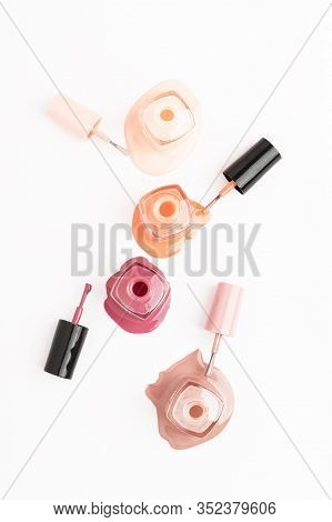 Open Unbranded Glass Bottle With Nail Polish. Poured Liquor Of Nail-varnish Isolated On White Backgr