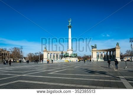 Budapest, Hungary - February 2020: Heroes Square Monument And Tourist In Budapest City.  The Square