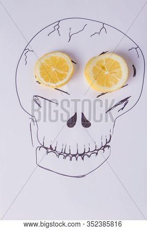 Hand Drawn Skull On White Background. Image Of Skull With Fresh Lemon Slices. Idea For Haloween Day.