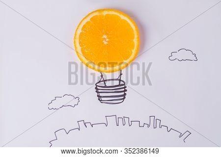 Orange Light Bulb. Orange In The Form Of Light Bulb. Fruit Light Lamp. Eco-friendly Light Energy Con
