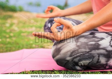 Lotus Pose. Close Up Gyan Mudra. Focus On One Hand. Yoga Outdoor. Young Woman Sitting On Yoga Mat, M