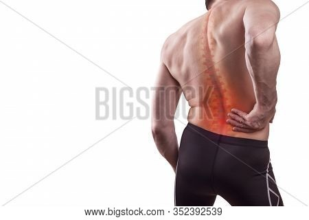Damage To The Lumbar Back. A Man Holds His Back In Pain. Concept Of Human Injury. Isolated On White
