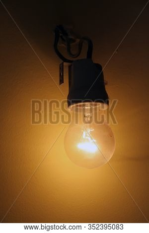 Old Light Bulb. Old Wired Light Bulb.