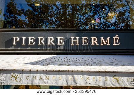 Paris/france - September 10, 2019 : The Pierre Herme Pastry Store Entrance Sign On Champs-elysees Av