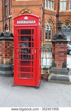 Leeds, Uk. Red Telephone And Leeds General Infirmary In Background.