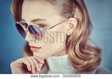 Modern business woman in formal clothes and sunglasses. Beauty, fashion. Optics and eyewear style. Close-up portrait.