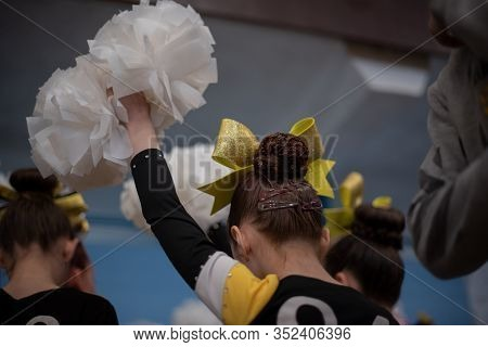 Cheerleader. Cheerleader Girl Of 9 Years In Anticipation Of A Sports Performance. The Girl Is A Spor