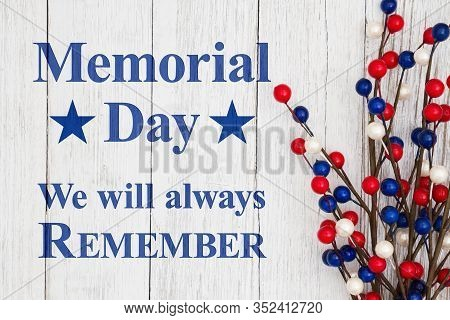Memorial Day We Will Always Remember Text With Red, White And Blue Berry Spray On Weathered Whitewas