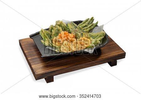 Japanese tempura with fresh vegetables deep friedisolated on white background .Japanese cuisine.