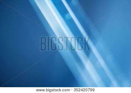 Abstract Lens Flare backdrop, Technology background, prism Bokeh Lights. Photo of Leaking Reflection of a Glass, Crystal, Defocused Shining Colorful Light Leaks, Rays blue Background