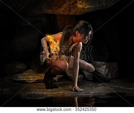 Thrill Seeking Female Exploring Alone Deep Into A Forgotten Ancient Cave In Search Of Adventure And